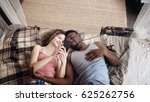 multiracial couple lying on bed.... | Shutterstock . vector #625262756