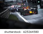 Small photo of Shanghai, China - April 9, 2017: F1 racing car leave pitlane to the track before the race at Formula One Chinese Grand Prix at Shanghai Circuit.