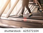 woman running in a gym on a... | Shutterstock . vector #625272104