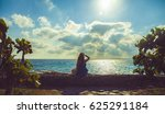 girl look in the distance ocean | Shutterstock . vector #625291184