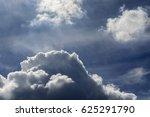 Backlit Cumulus Clouds Against...