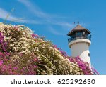 Lighthouse In Sunny Day With...