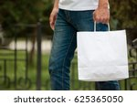 man with a white paper bag in... | Shutterstock . vector #625365050