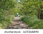 person walking in the woods... | Shutterstock . vector #625368890
