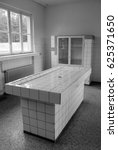 Small photo of SACHSENHAUSEN-ORANIENBURG, GERMANY MAY 24 10: Nazi concentration camp in Germany, Autopsy room in the Pathology Department, KL-Sachsenhausen medical post mortem table which is now a Museum