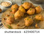 Stock photo homemade deep fried hush puppy corn fritters 625400714