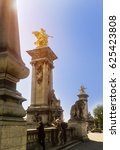 Small photo of Bridge Alexander III and the river Seine, Paris. Columns crowned at the top, near the golden eagles PARIS, FRANCE APRIL 17, 2014