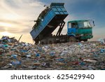 Dump Truck Unloading Waste On A ...
