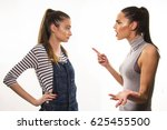 Small photo of two girls having hard talk, polemic and argue between friends, sisters or soommate concept