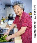 Happy Grandmother  Cooking...