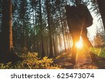 young man walks in forrest and... | Shutterstock . vector #625473074