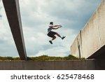young man doing parkour jump ... | Shutterstock . vector #625478468