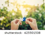 hands connecting jigsaw puzzle  ... | Shutterstock . vector #625501538