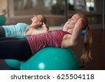two young women exercising with ...   Shutterstock . vector #625504118