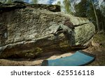 a man bouldering on a big rock... | Shutterstock . vector #625516118