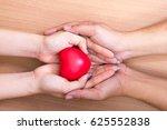 red heart in the hands of... | Shutterstock . vector #625552838