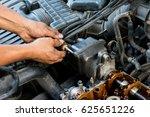 mechanic hands tighten nut with ... | Shutterstock . vector #625651226