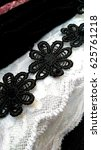 Small photo of Black Flower Lace on White Lace