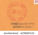 Small photo of USA - CIRCA 2017:stamp printed by USA,shows First-class mail International.The postmark USPS on the orange envelope,circa 2017