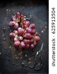 wet bunch of red grapes laying... | Shutterstock . vector #625913504