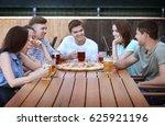 happy friends in pizzeria | Shutterstock . vector #625921196
