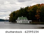 Triple boathouse - stock photo