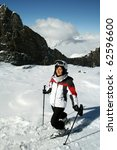 Portrait of young cute woman.Ski and sunburn.Mountain background - stock photo