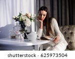 morning. young woman sitting at ...   Shutterstock . vector #625973504