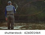 a fisherman fishing with fly... | Shutterstock . vector #626001464