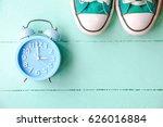 Blue Alarm Clock And Green...