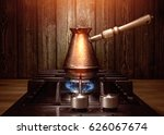 turka for coffee on the hob | Shutterstock . vector #626067674
