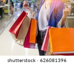 Woman Holding Shopping Bag In...