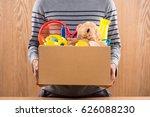 male volunteer holding donation ...   Shutterstock . vector #626088230