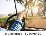 golfer driving golf cart   Shutterstock . vector #626098490