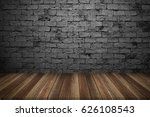 wood table with brick wall... | Shutterstock . vector #626108543