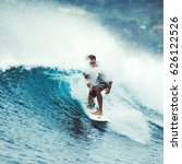 surfer on the wave. the surfer... | Shutterstock . vector #626122526