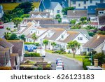 Small photo of Aerial view of a modern neighborhood.Residential area View of the street neighborhood from top. Residential street background.City street neighborhood residences.City Residential street