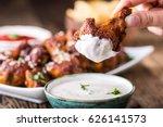 fried chicken wings on slate... | Shutterstock . vector #626141573
