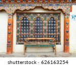 Colorful Window And Wooden Bench
