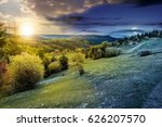 composite countryside landscape. day and night time change concept. forest in mountain rural area. grassy agricultural field on a hillside. beautiful summer scenery - stock photo