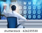 male doctor looking at mri scans | Shutterstock . vector #626235530
