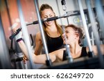 personal trainer helps with gym ... | Shutterstock . vector #626249720