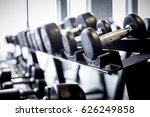 rows of dumbbells on a rack in... | Shutterstock . vector #626249858