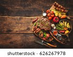 grilled meat and vegetables on... | Shutterstock . vector #626267978