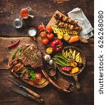grilled meat and vegetables on... | Shutterstock . vector #626268080
