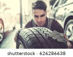 handsome young auto mechanic in ... | Shutterstock . vector #626286638