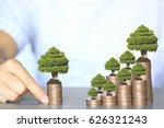 trees growing on coins money ... | Shutterstock . vector #626321243