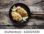 roasted chicken breast lying on ... | Shutterstock . vector #626324330