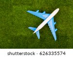 toy plane on the grass meadow.... | Shutterstock . vector #626335574