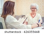 senior woman is visited by her... | Shutterstock . vector #626355668